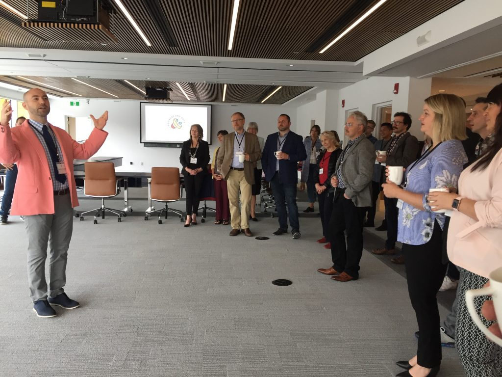 "Board member Dr. Ian Sutherland shares news about BANL's new program ""Design Thinking: Collaboration for Innovation"" at a recent Sunrise event."